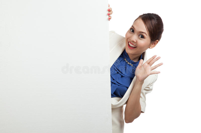 Excited young Asian woman with blank sign royalty free stock image