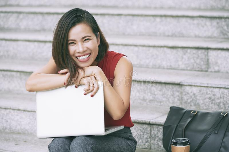 Excited young business woman stock photo