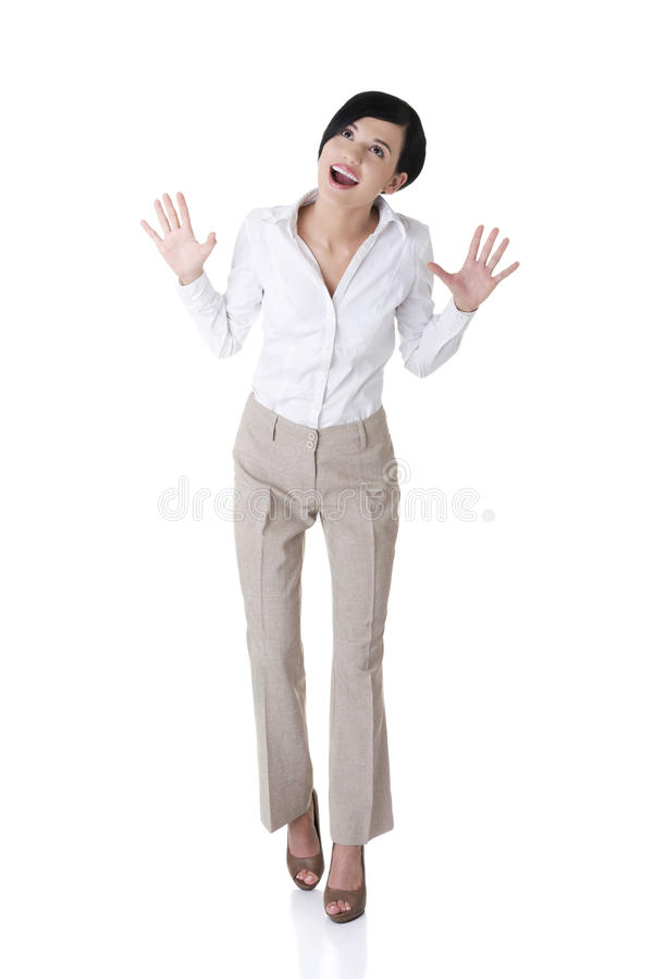 Excited Young Business Woman Looking Up Stock Images