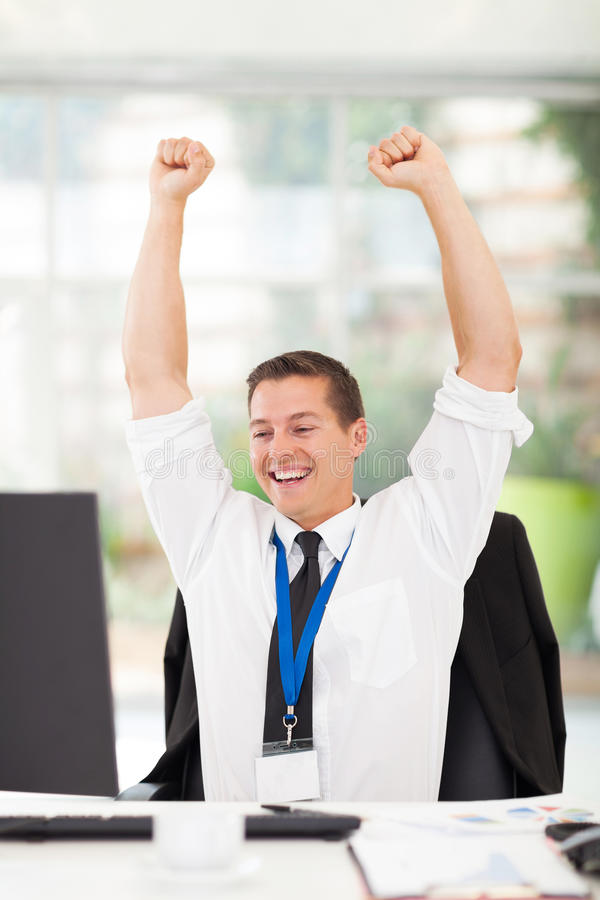 Download Excited young businessman stock photo. Image of corporate - 34017870