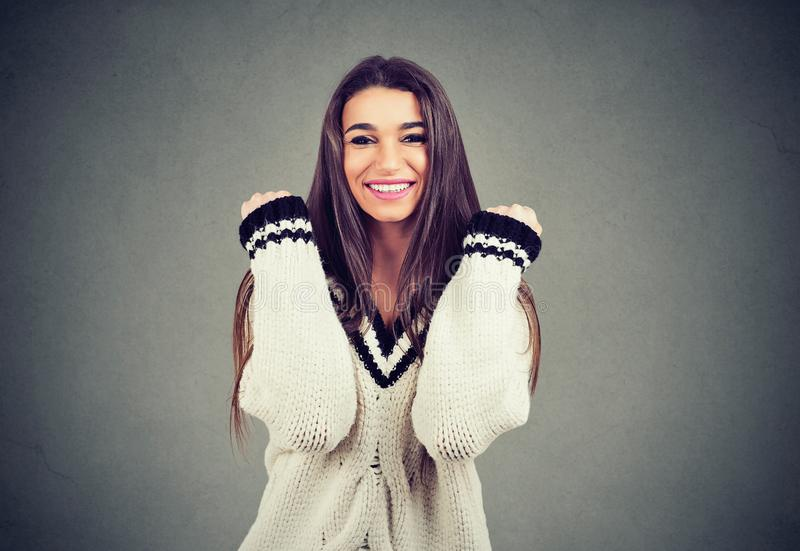 Excited young casual girl feeling super happy royalty free stock photo