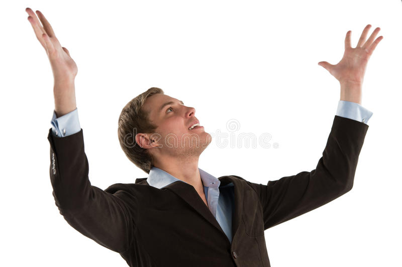 Excited young executive celebrating the success of his business stock photography