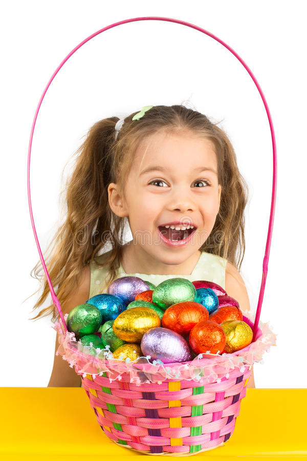 Young Girl and the Basket with Chocolate Eggs stock images