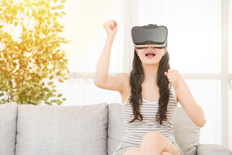 Excited young girl winning VR video game royalty free stock photos
