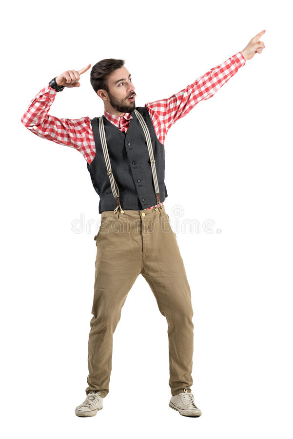 Excited young hipster winner pointing up celebrating royalty free stock photo