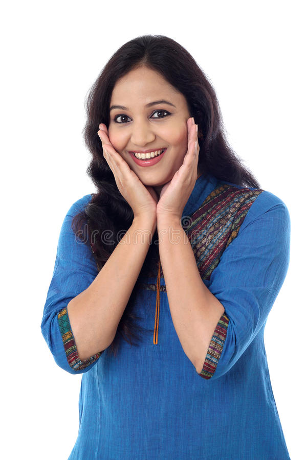 Excited young indian woman against white background royalty free stock photo