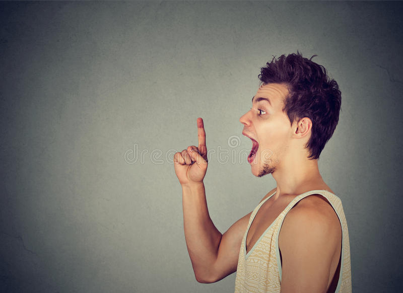 Excited young man has a new idea pointing finger up stock photo