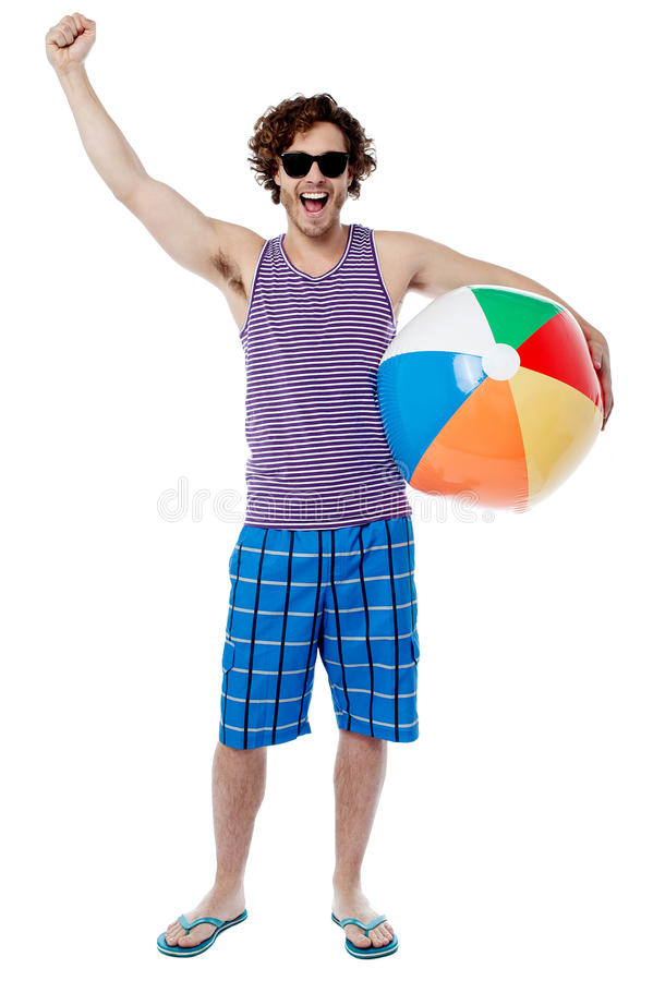 Excited young man raising his arm royalty free stock photo