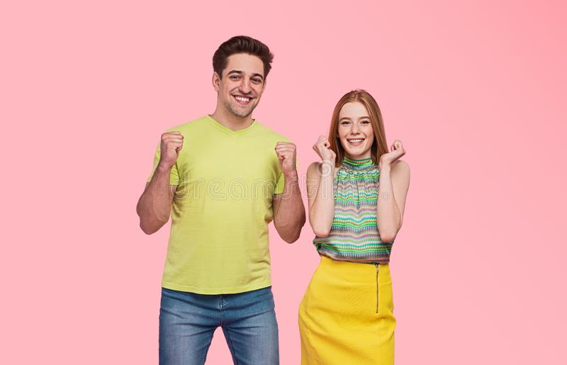 Happy couple celebrating victory together stock images