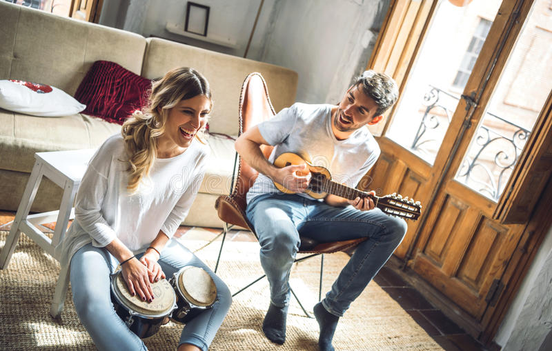 Excited young people playing musical instruments stock photo