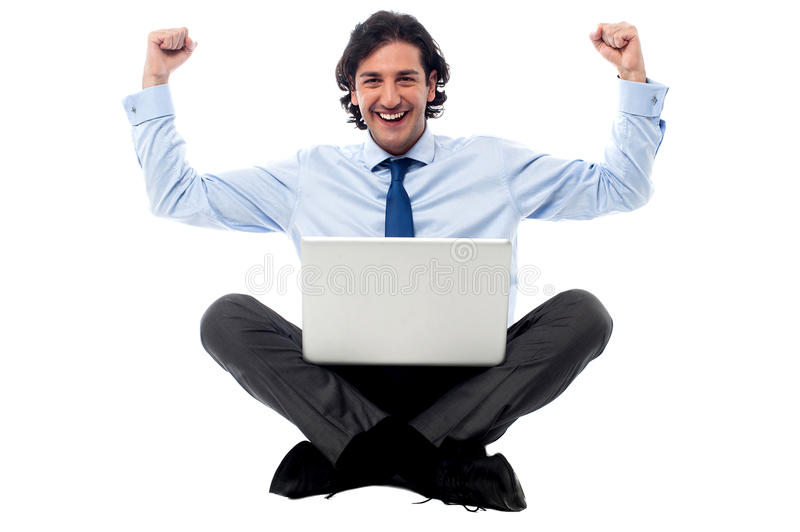Excited young professional with laptop royalty free stock image