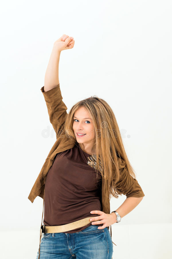 Excited young woman celebrating success. On white background royalty free stock photo