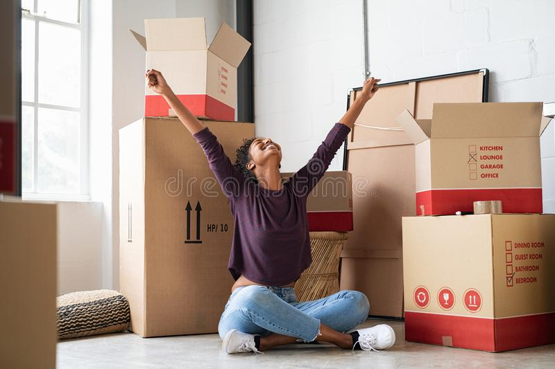 Excited young woman in new house stock photography