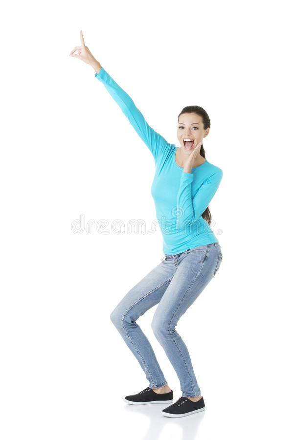 Download Excited Young Woman Pointing On Copy Space Stock Photo - Image of displaying, advertisement: 27898456