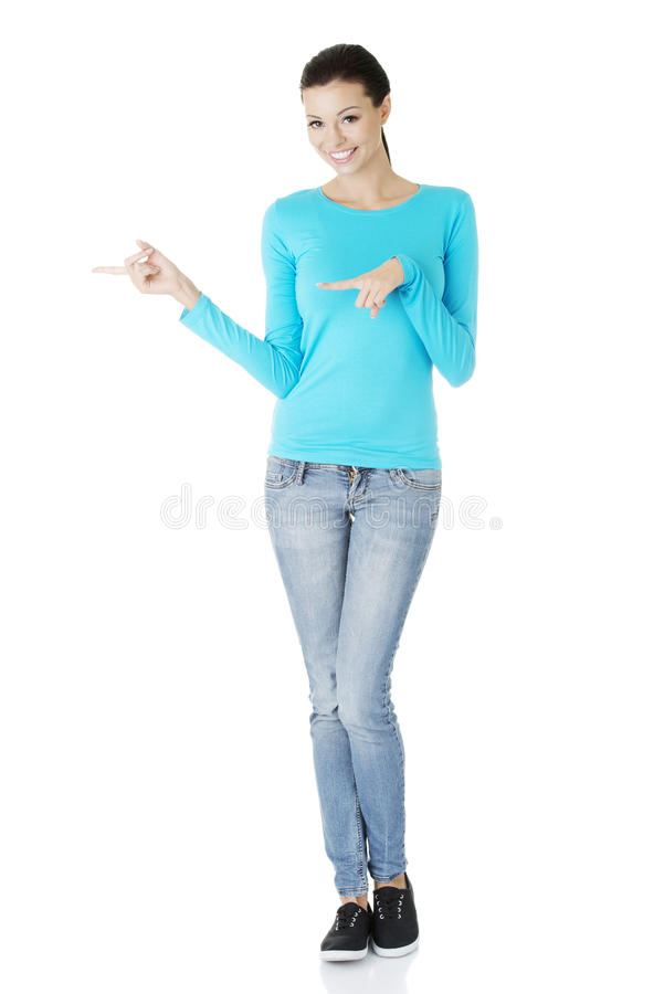 Excited Young Woman Pointing On Copy Space Stock Photos