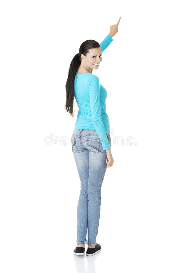 Download Excited Young Woman Pointing On Copy Space Stock Photo - Image: 27898498