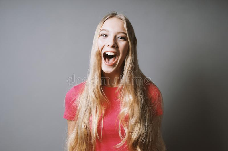 Excited young woman whoop of joy or shout of delight stock photography
