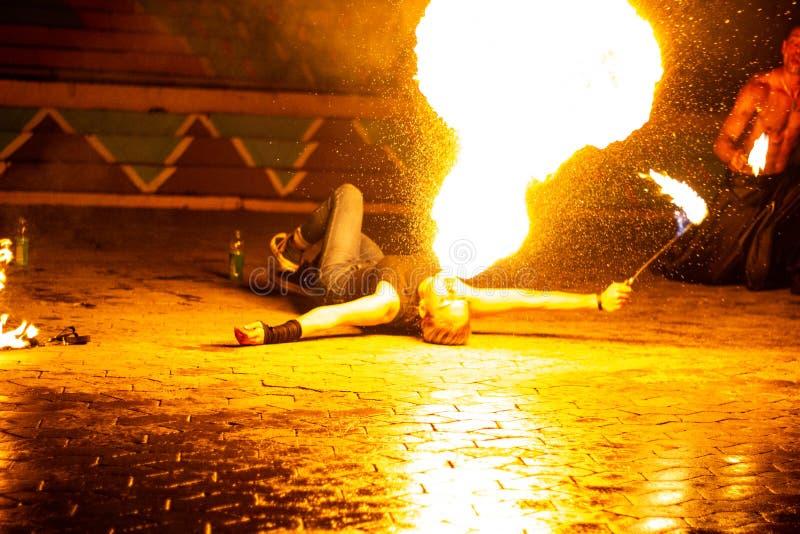 Mesmerizing fiery breath at night stock photo