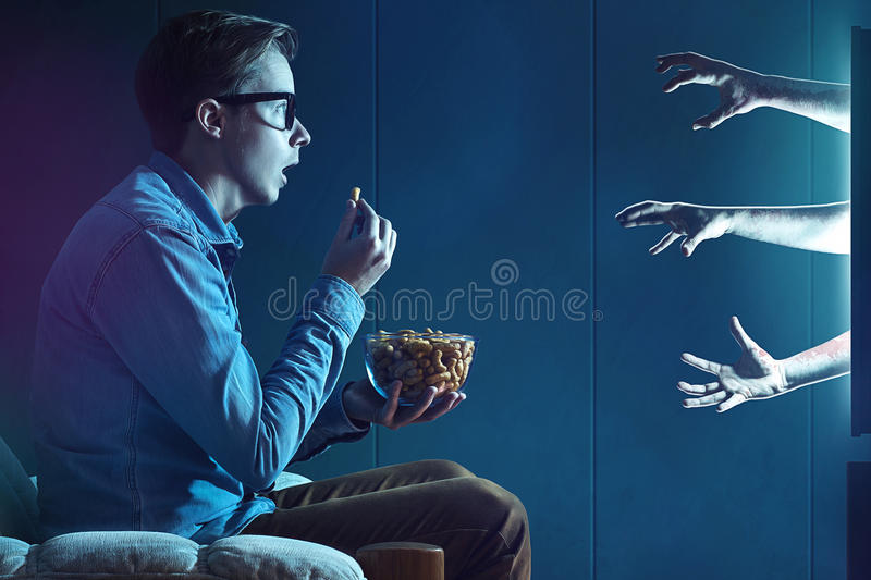 Exciting Movie. Man looking an exciting Movie stock photo