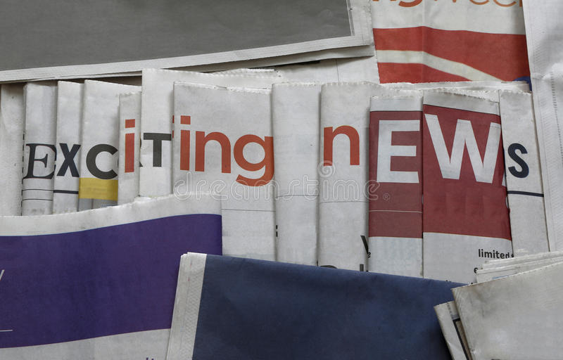 Exciting news background. Newspaper arranged to display ` exciting news stock photography