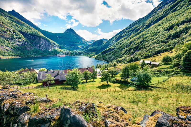 Exciting summer scene of Geiranger port, western Norway. Sunny view of Sunnylvsfjorden fjord. Traveling concept background. royalty free stock photography