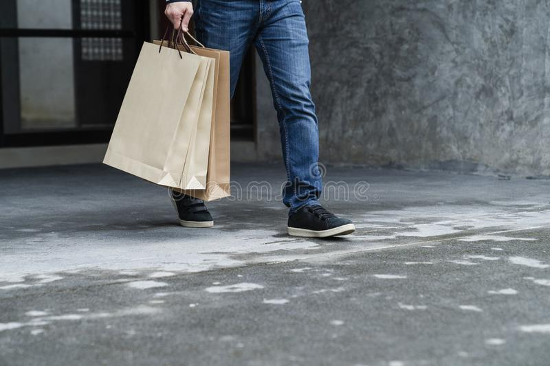 Exciting young shopping man hold bags stock photography