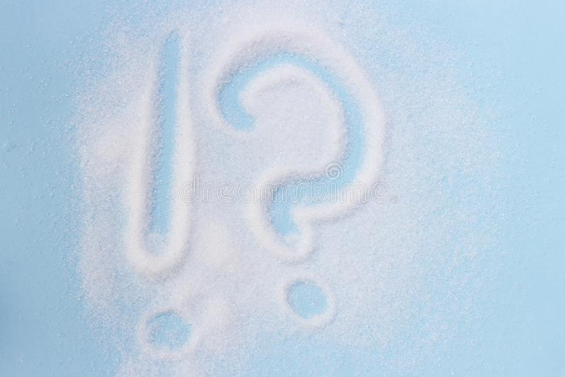 Exclamation mark and question mark written on sugar, health care, healthy eating concept.  royalty free stock image