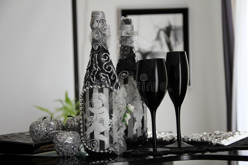 Exclusive bottle black glasses stock images