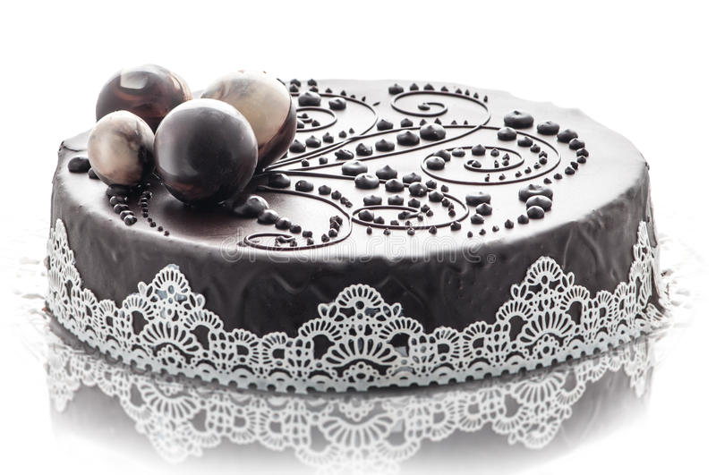 Exclusive chocolate cake with lace and chocolate decoration, patisserie, photography for shop, sweet dessert royalty free stock photo