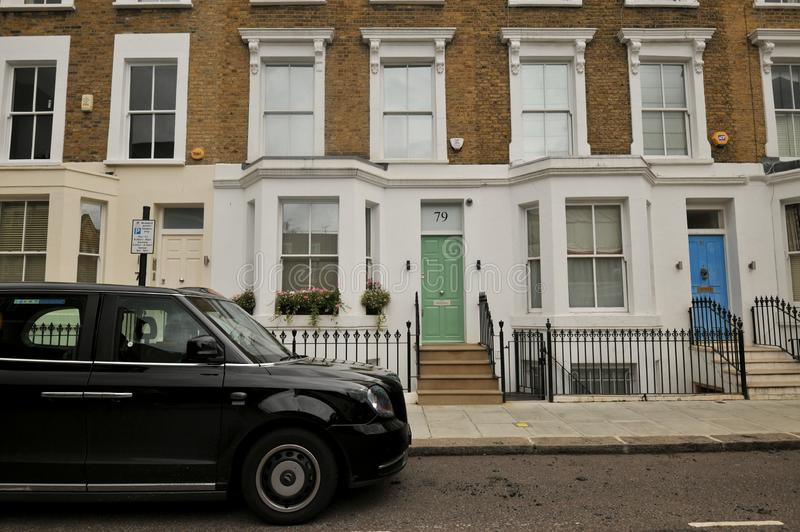 The exclusive district Chelsea in London, England. Chelsea district is entirely within the Royal Borough of Kensington and Chelsea, although Chelsea gives its royalty free stock photos