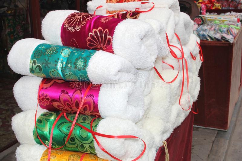 Exclusive souvenirs, gloves (sleeves) of fur and silk in walled city Pingyao, China stock photos