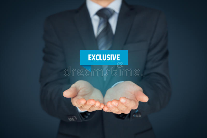Exclusive offer. And exclusivity business model. Businessman hold virtual label with text exclusive stock photography