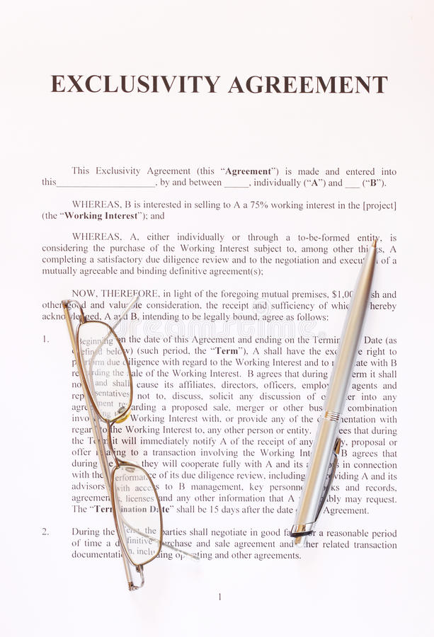 Exclusivity Agreement Form With Pen And Glasses Royalty Free Stock