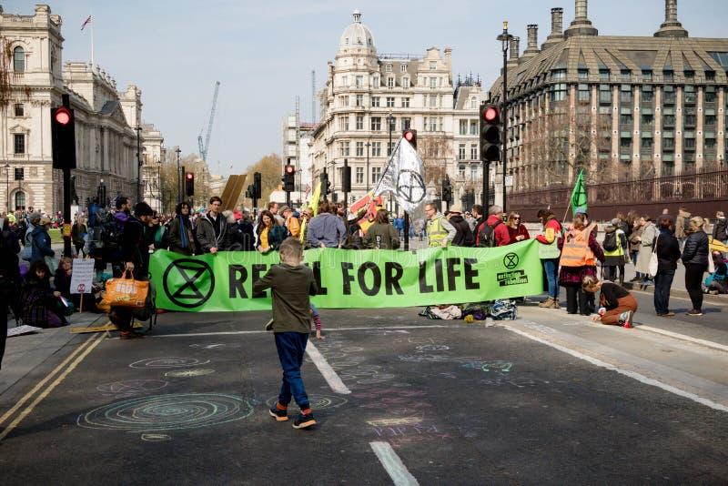 Exctintion revoltprotest i centrala London arkivfoton
