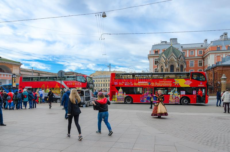 Excursion buses near chapel-sacristy of Iberian Icon of Mother of God Stone Museum, St.Petersburg, Russia. SAINT PETERSBURG, RUSSIA - MAY 1, 2017: Group of royalty free stock image