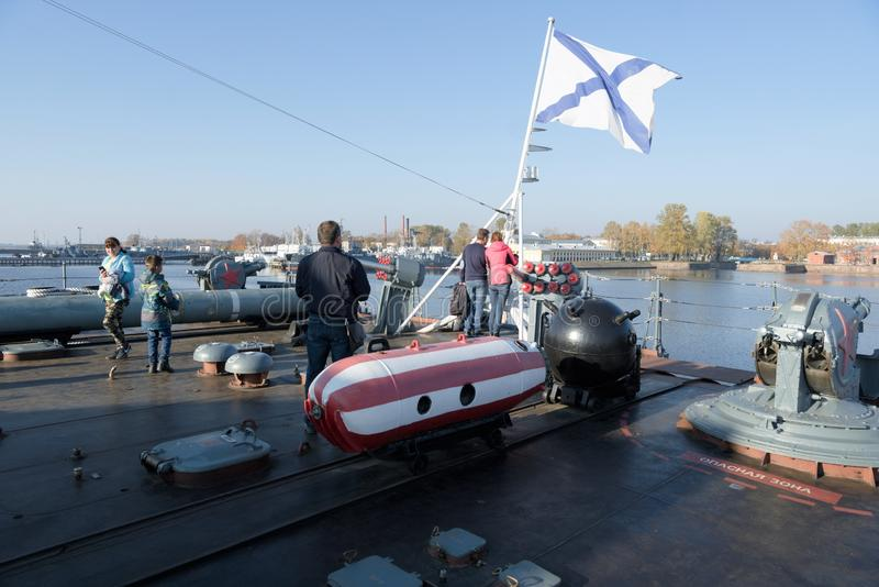 Kronstadt, Russia, October 2018. Excursion on the deck of the destroyer in the bay of the city. Excursion on the deck of the destroyer in the bay of the city royalty free stock photos