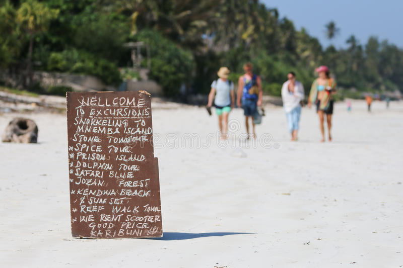 Excursions. Board with excursions on the beach of Zanzibar stock photos