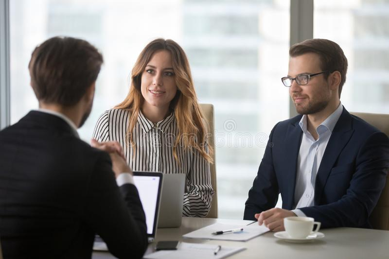 Executing colleagues listening to partner making business offer at meeting royalty free stock photography