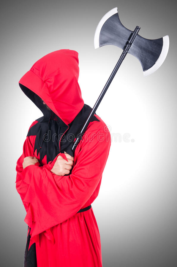 Executioner in red costume royalty free stock photo