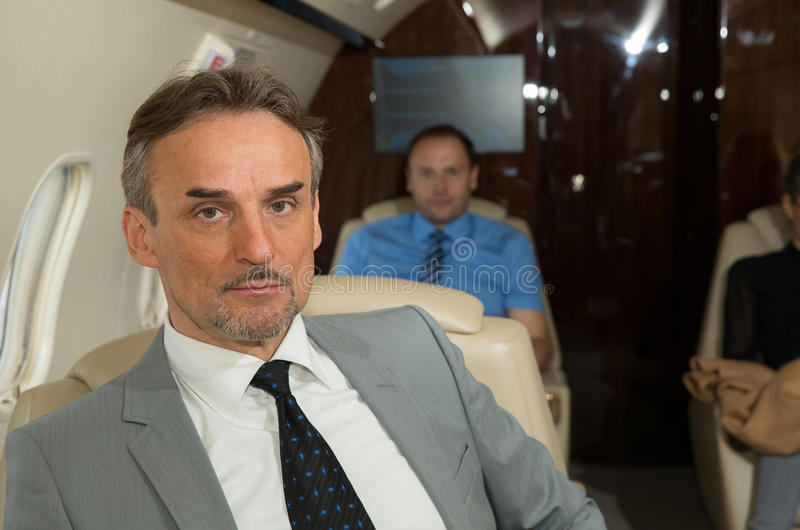 Executive business manager in an airplane portrait stock images