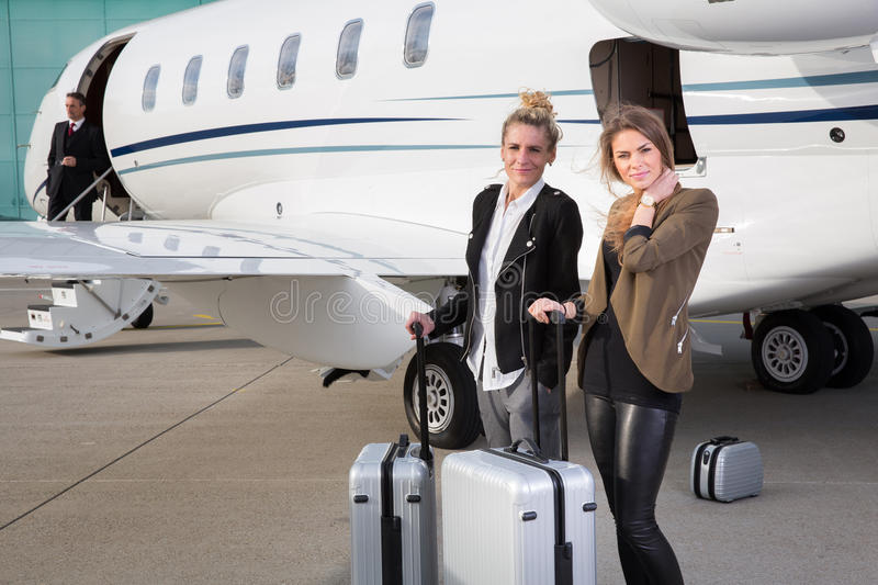 Executive business team leaving corporate jet. On a runway stock images