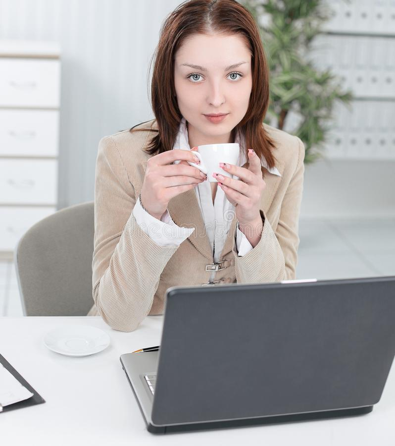 Executive business woman with a Cup of coffee. royalty free stock photography