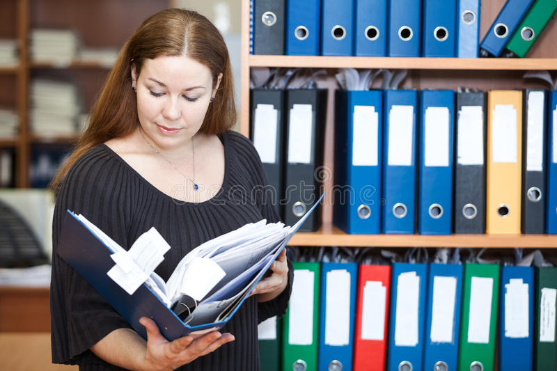 Download Executive Business Woman Looking At Documents Stock Image - Image: 30498593