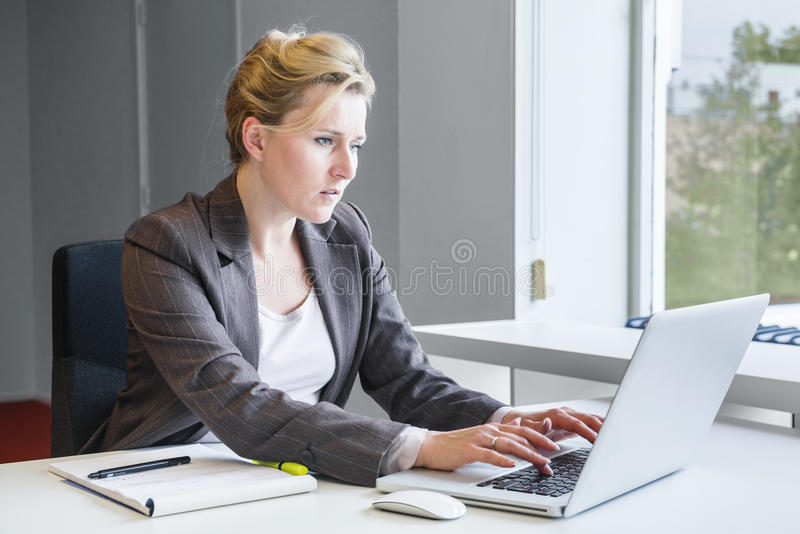 Executive business woman with notebook stock images