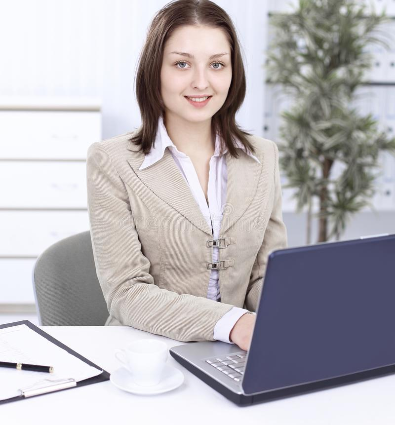 Executive business woman sitting at her Desk stock images
