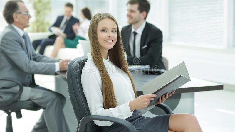 Executive business woman with clipboard modern office stock photos
