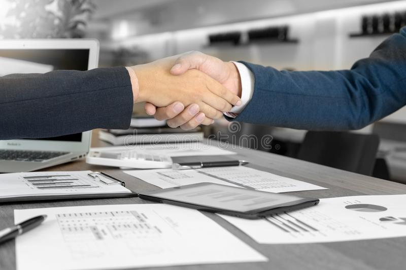 executive businessman hand shake with another business man stock photo