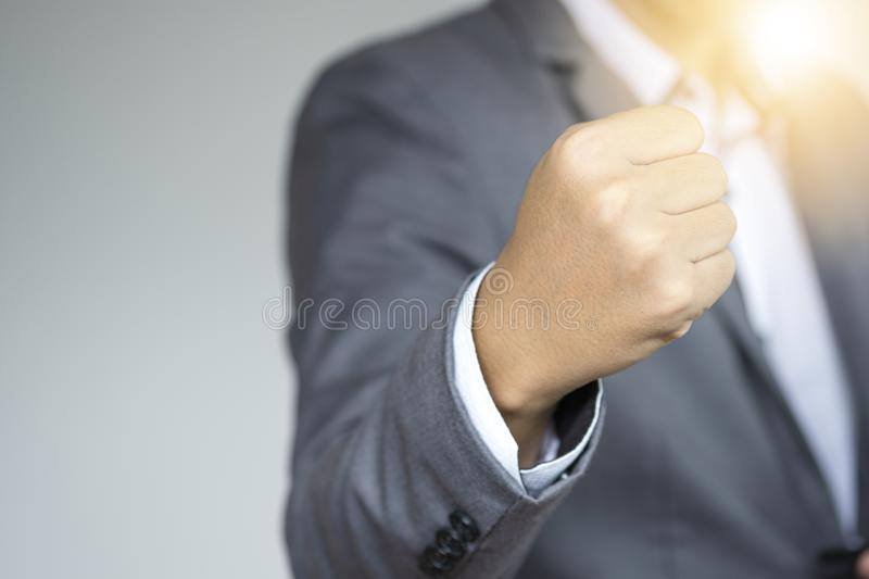 Executive businessman raise up fist hand for accelerate mind for fighting. Young businessman start up and successful concept. stock image
