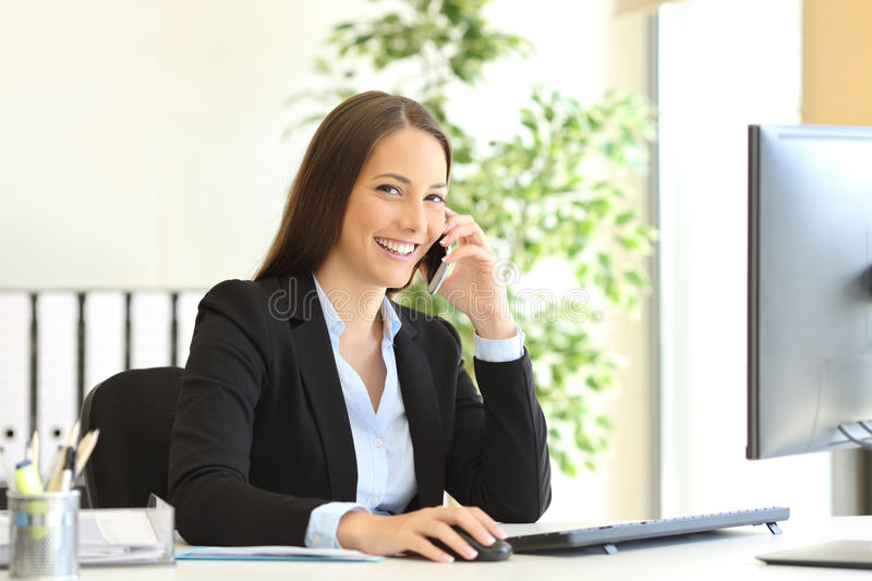 Executive calling on phone and looking at camera stock image