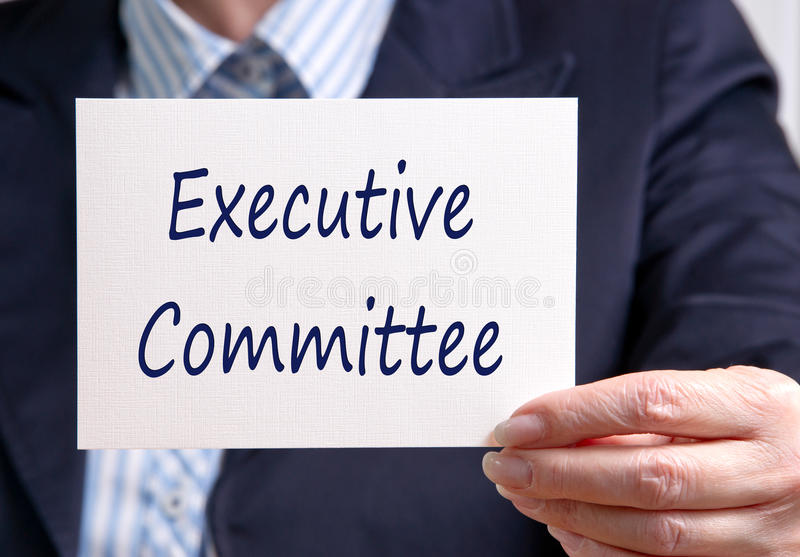 Executive Committee. Businesswoman holding sign with text royalty free stock image